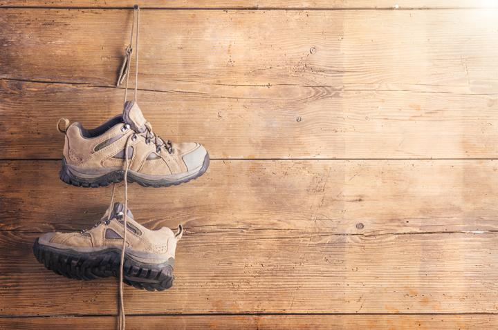 hiking shoes wooden board background